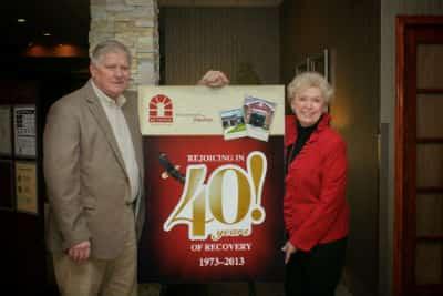 Dr-Gene-Regier-and-Carol-40th-sign-400